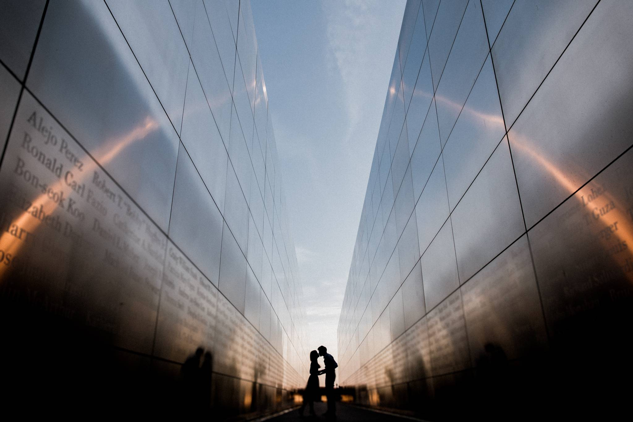 Silhouette of couple in open sky memorial at Liberty State Park